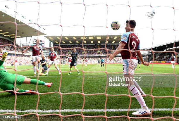 Matthew Lowton of Burnley fails to Sergio Aguero of Manchester City from scoring his team's first goal during the Premier League match between...