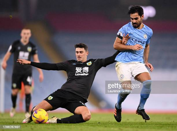 Matthew Lowton of Burnley is challenged by Ilkay Gundogan of Manchester City during the Premier League match between Manchester City and Burnley at...