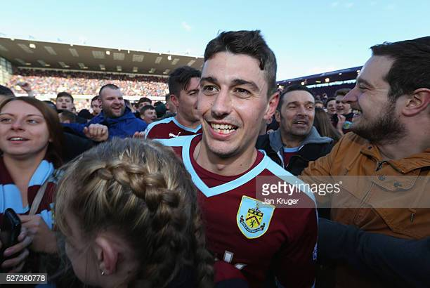 Matthew Lowton of Burnley is congratulated as fans invade the pitch in celebration as Burnley are promoted to the Premier League after the Sky Bet...