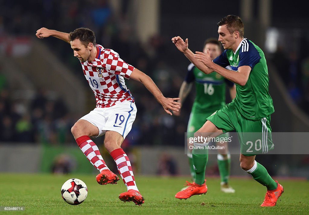 Matthew Lund (R) of Northern Ireland and Milan Badelj (L) of Croatia during the international friendly fixture between Northern Ireland and Croatia at Windsor Park on November 15, 2016 in Belfast, Northern Ireland.