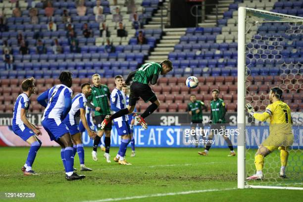 Matthew Lund of Rochdale scores his sides second goal during the Sky Bet League One match between Wigan Athletic and Rochdale at DW Stadium on...