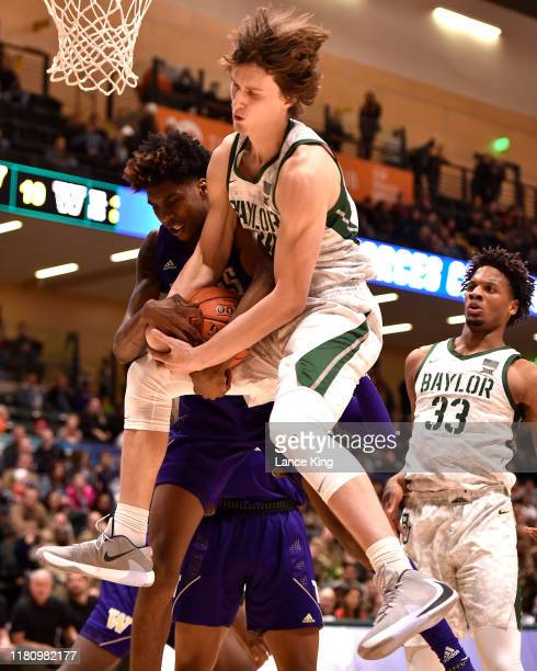 Matthew Mayer of the Baylor Bears and Jaden McDaniels of the Washington Huskies battle for a rebound in the first half during the ESPN Armed Forces...