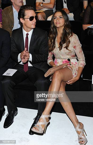Matthew McConaughey and Camila Alves attend the Dolce Gabbana Milan Menswear Spring/Summer 2011 show on June 19 2010 in Milan Italy