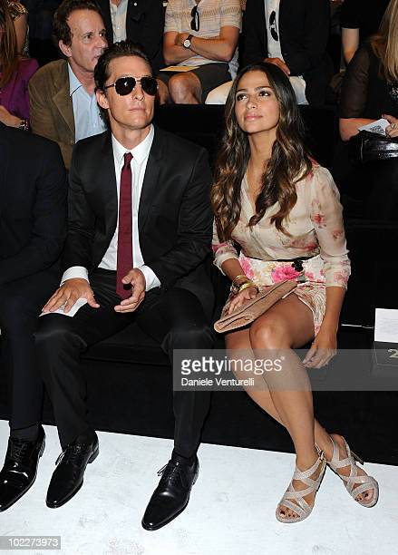 Matthew McConaughey and Camila Alves attend the Dolce & Gabbana Milan Menswear Spring/Summer 2011 show on June 19, 2010 in Milan, Italy.