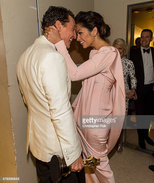 Matthew McConaughey and Camila Alves kiss backstage during the Oscars held at Dolby Theatre on March 2 2014 in Hollywood California