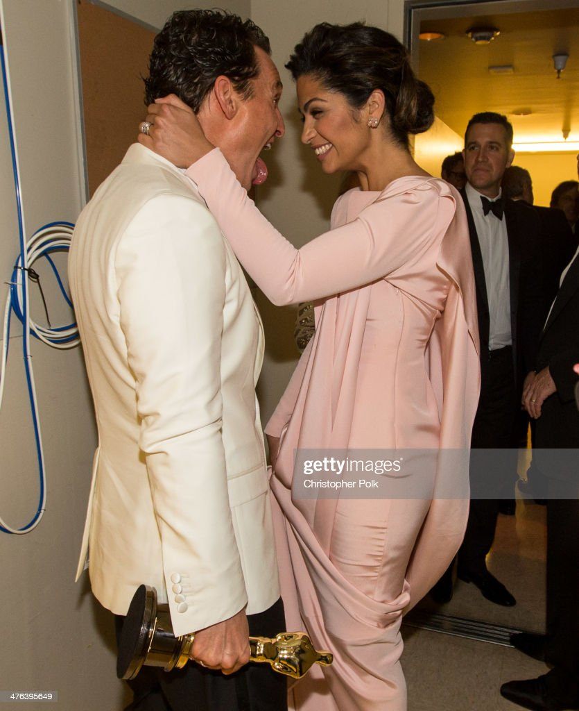 Matthew McConaughey and Camila Alves kiss backstage during the Oscars held at Dolby Theatre on March 2, 2014 in Hollywood, California.