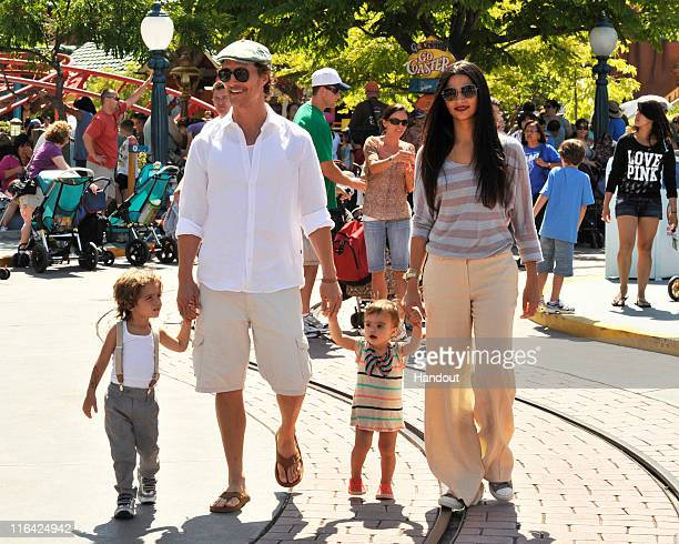 Matthew McConaughey and Camila Alves stroll through Mickey's Toontown with their children, son Levi and daughter Vida at Disneyland park on June 15,...