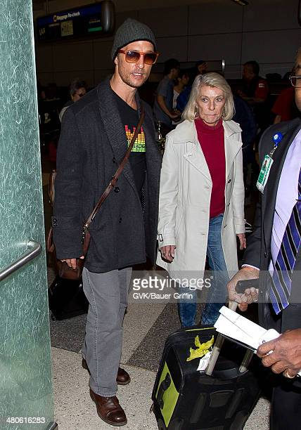Matthew McConaughey and his mother Mary McCabe are seen at Los Angeles International airport on March 25 2014 in Los Angeles California