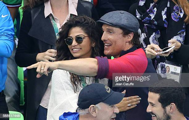 Matthew McConaughey and his wife Camila Alves attend the swimming finals on day 5 of the Rio 2016 Olympic Games at Olympic Aquatics Stadium on August...
