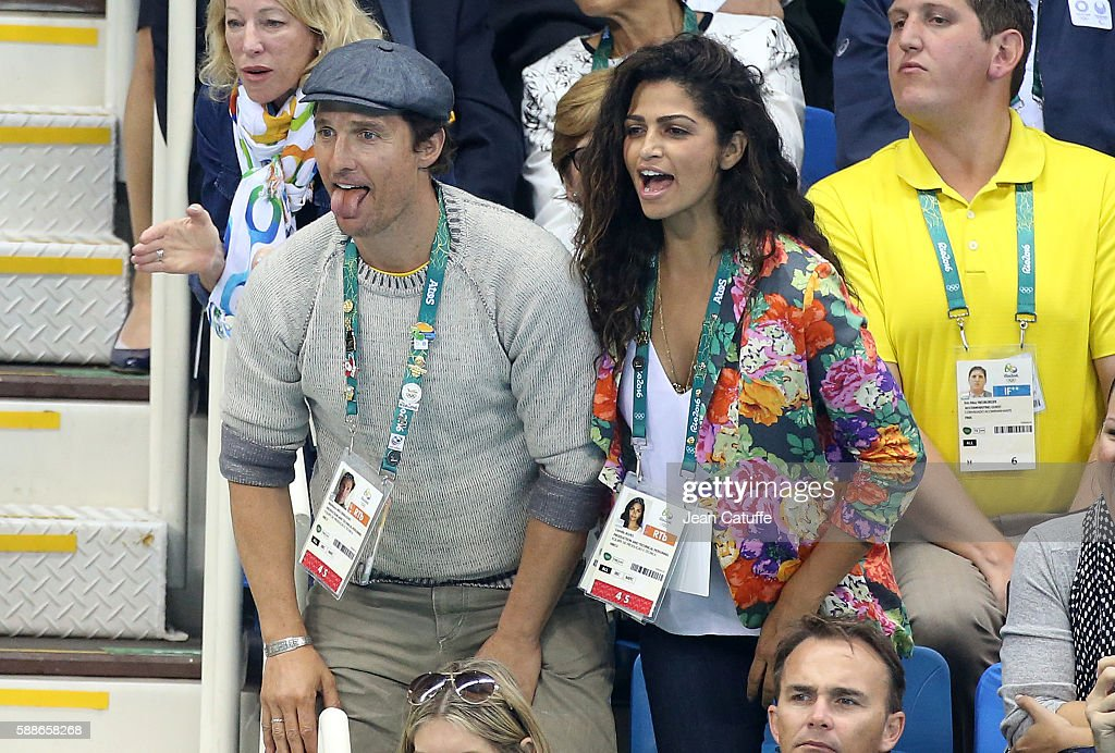 Matthew McConaughey and his wife Camila Alves attend the swimming finals on day 6 of the Rio 2016 Olympic Games at Olympic Aquatics Stadium on August 11, 2016 in Rio de Janeiro, Brazil.