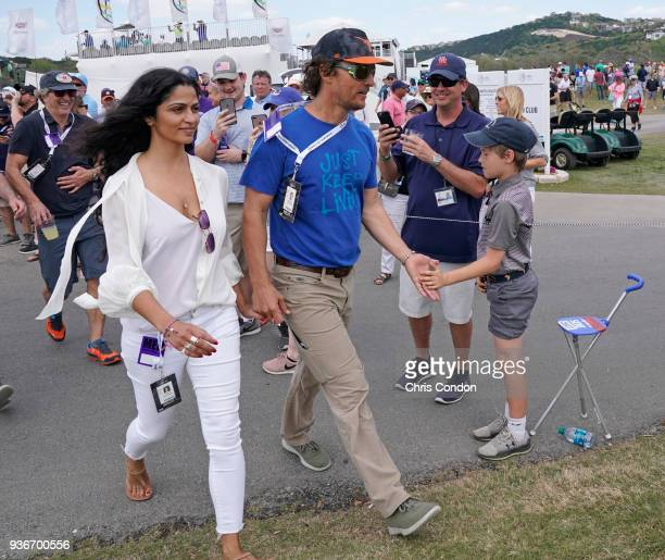 Matthew McConaughey and his wife Camila watch some golf during round two of the World Golf Championships Dell Technologies Match Play at Austin...