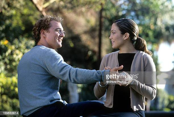 Matthew McConaughey flirts with Jennifer Lopez in a scene from the film 'The Wedding Planner' 2001