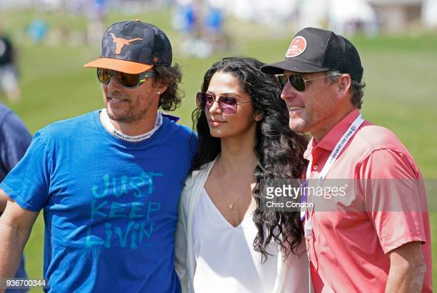 Matthew McConaughey his wife Camila and Lance Armstrong watch some golf during round two of the World Golf Championships Dell Technologies Match Play...