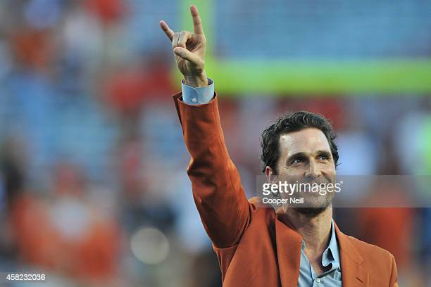 Matthew McConaughey puts his horns up before kickoff between the Texas Longhorns and Iowa State Cyclones on October 18 2014 at Darrell K RoyalTexas...