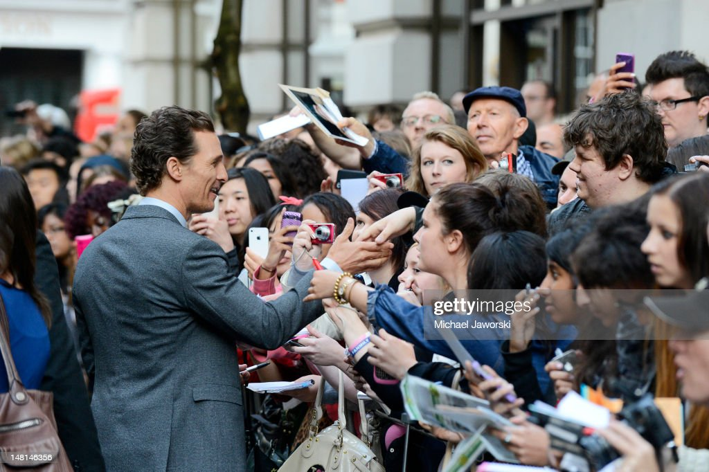 Matthew McConaughey signs autographs outside the Mayfair Hotel ahead of the European Premiere of Magic Mike on July 10, 2012 in London, England.