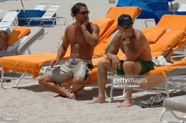 Matthew McConaughey sits with a friend on South Beach on August 8 2006 in Miami Beach Florida