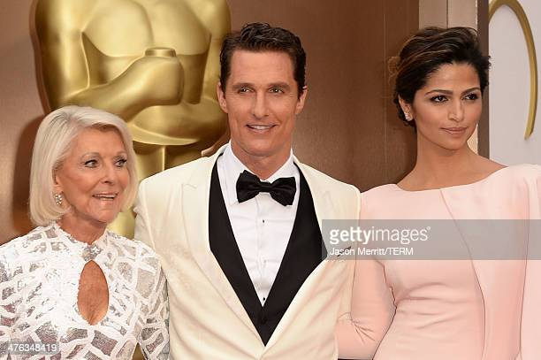 Matthew McConaughey with mother Mary Kathlene and wife Camila Alves attends the Oscars held at Hollywood Highland Center on March 2 2014 in Hollywood...