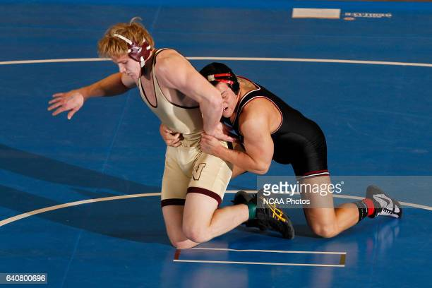 Matthew Meuleners of Northern State wrestles Jake Kahnke of St Cloud State during the Division II Men's Wrestling Championship held at the UNK Health...