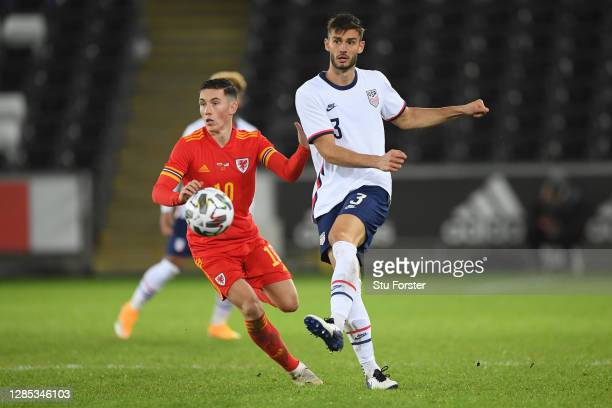Matthew Miazga of USA passes the ball under pressure from Harry Wilson of Wales during the international friendly match between Wales and the USA at...