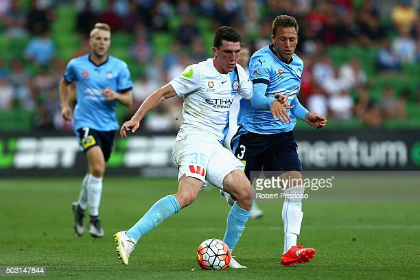 Matthew Millar of Melbourne City and Alexander Gersbach of Sydney contest the ball during the round 13 ALeague match between Melbourne City FC and...