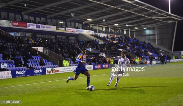 Matthew Millar of Shrewsbury and Cameron Burgess of Arrington Stanley in action during the Sky Bet League One match between Shrewsbury Town and...
