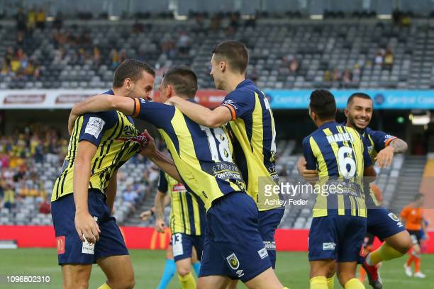 Matthew Millar of the Central Coast Mariners celebrates his goal with team mates during the round 14 A-League match between the Central Coast...