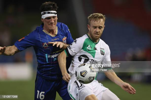 Matthew Millar of the Jets contests the ball against Connor Pain of Western United during the A-League match between the Newcastle Jets and Western...