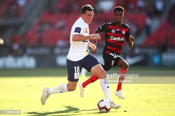 Matthew Millar of the Mariners dribbles the ball during the round 18 ALeague match between the Western Sydney Wanderers and the Central Coast...