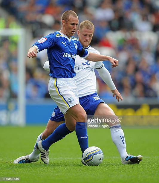 Matthew Mills of Leicester in action with Kenny Miller of Cardiff during the npower Championship match between Cardiff City and Leicester City at the...