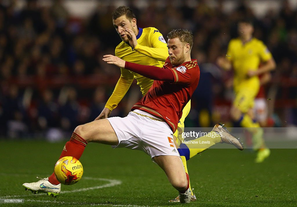 Matthew Mills of Nottingham Forest and Chris Wood of Leeds United challenge for the ball during the Sky Bet Championship match between Nottingham Forest and Leeds United on December 27, 2015 in Nottingham, United Kingdom.
