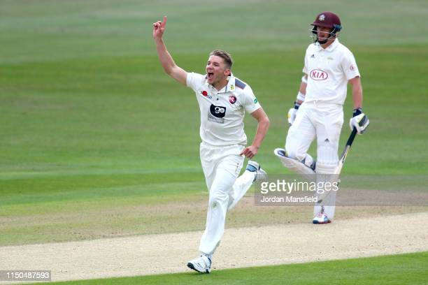 Matthew Milnes of Kent celebrates dismissing Dean Elgar of Surrey during day one of the Specsavers County Championship Division One match between...