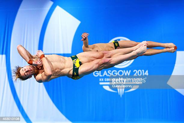 Matthew Mitcham and Grant Nel of Australia compete in the Men's Synchronised 3m Springboard Final at Royal Commonwealth Pool during day nine of the...