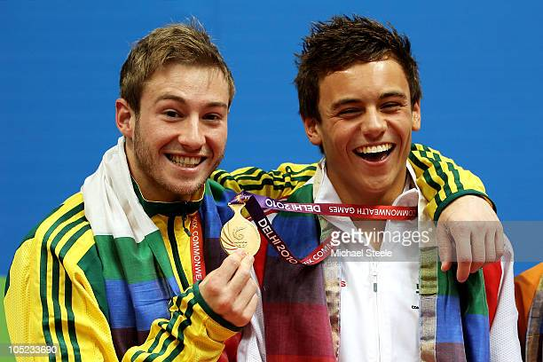 Matthew Mitcham and Tom Daley of England pose with the medals won in the Men's 10m Platform Final at the Dr. S.P. Mukherjee Aquatics Complex during...