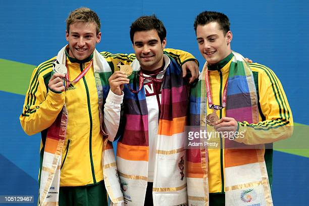 Matthew Mitcham of Australia, Alexandre Despatie of Canada and Scott Robertson of Australia pose with the medals won in the Men's 1m Springboard...