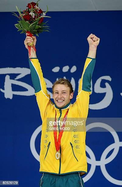 Matthew Mitcham of Australia celebrates after receiving his gold medal won during the final of the men's 10m platform diving at the 2008 Beijing...