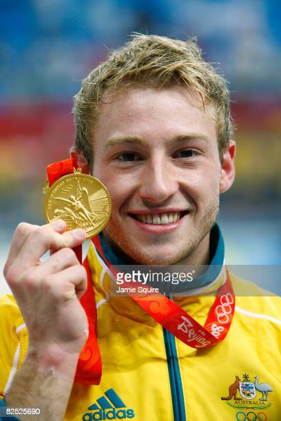 Matthew Mitcham of Australia celebrates his gold medal in the Men's 10m Platform Final diving event held at the National Aquatics Center on Day 15 of...