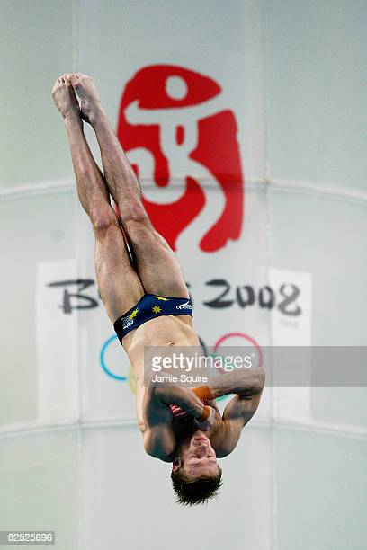 Matthew Mitcham of Australia completes his final dive in the Men's 10m Platform Final diving event held at the National Aquatics Center on Day 15 of...