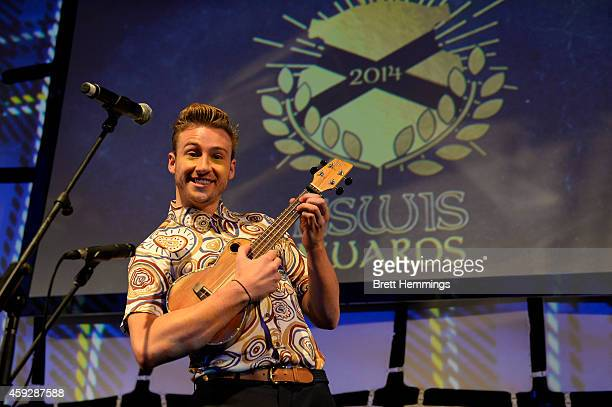 Matthew Mitcham plays a ucalaly on stage during the NSWIS Awards at Royal Randwick Racecourse on November 20, 2014 in Sydney, Australia.