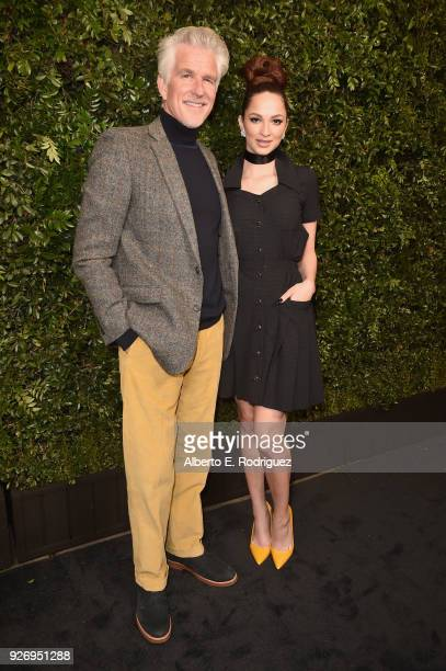 Matthew Modine and Caridad Modine attend Charles Finch and Chanel PreOscar Awards Dinner at Madeo in Beverly Hills on March 3 2018 in Beverly Hills...