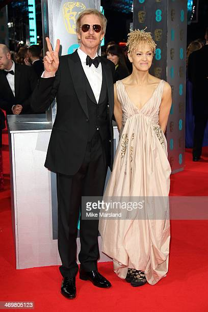 Matthew Modine and wife Caridad Rivera attend the EE British Academy Film Awards 2014 at The Royal Opera House on February 16 2014 in London England