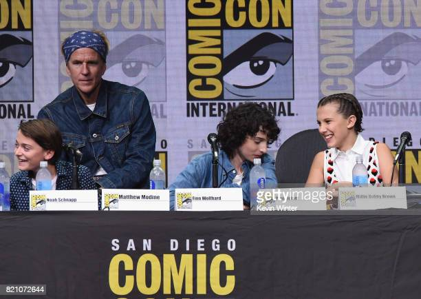Matthew Modine Noah Schnapp Finn Wolfhard and Millie Bobby Brown attend Netflix's 'Stranger Things' panel during ComicCon International 2017 at San...