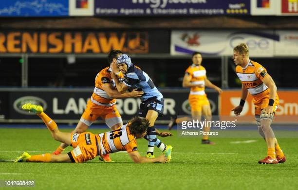 Matthew Morgan of Cardiff Blues is tackled by Nico Lee of Toyota Cheetahs during the Guinness Pro14 Round 5 match between Cardiff Blues and Toyota...