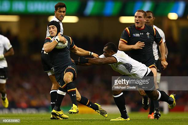 Matthew Morgan of Wales in action with Vereniki Goneva of Fiji during the 2015 Rugby World Cup Pool A match between Wales and Fiji at the Millennium...