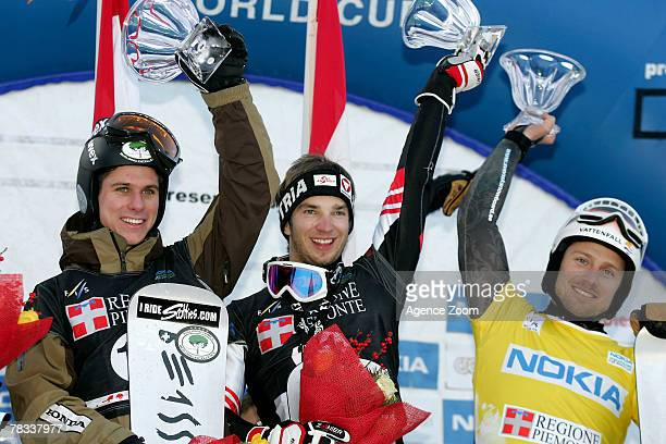 Matthew Morion of Canada Manuel Veith of Austria and Daniel Biveson of Sweden during the FIS Snowboard World Cup Men's Parallel GS on December 08...