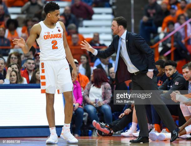 Matthew Moyer talks with assistant coach Gerry McNamara of the Syracuse Orange against the North Carolina State Wolfpack during the second half at...