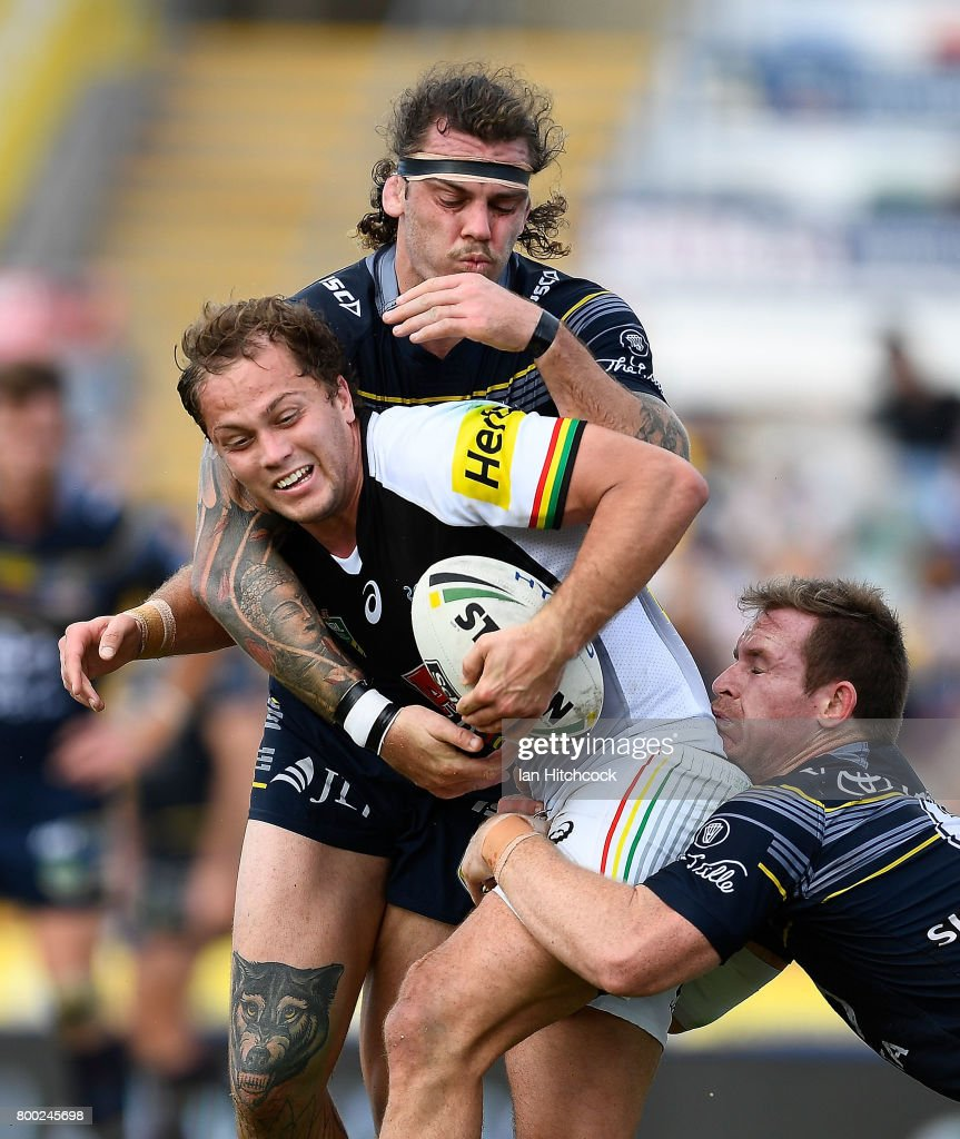 Matthew Moylan of the Panthers is tackled by Michael Morgan and Ethan Lowe of the Cowboys during the round 16 NRL match between the North Queensland Cowboys and the Penrith Panthers at 1300SMILES Stadium on June 24, 2017 in Townsville, Australia.