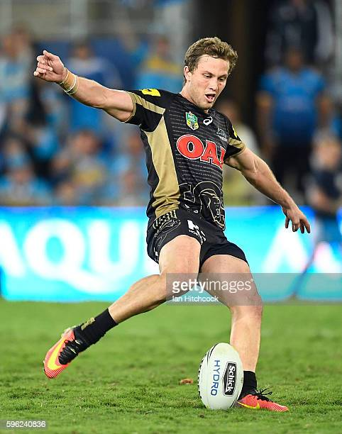 Matthew Moylan of the Panthers kicks the winning field goal during the round 25 NRL match between the Gold Coast Titans and the Penrith Panthers at...