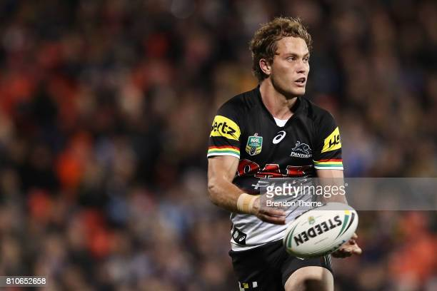 Matthew Moylan of the Panthers passes the ball to a team mate during the round 18 NRL match between the Penrith Panthers and the Manly Sea Eagles at...