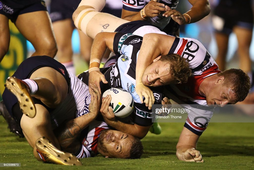 Matthew Moylan of the Sharks is tackled by Roosters defence during the round five NRL match between the Cronulla Sharks and the Sydney Roosters at Southern Cross Group Stadium on April 6, 2018 in Sydney, Australia.