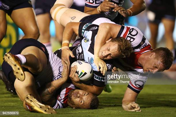 Matthew Moylan of the Sharks is tackled by Roosters defence during the round five NRL match between the Cronulla Sharks and the Sydney Roosters at...